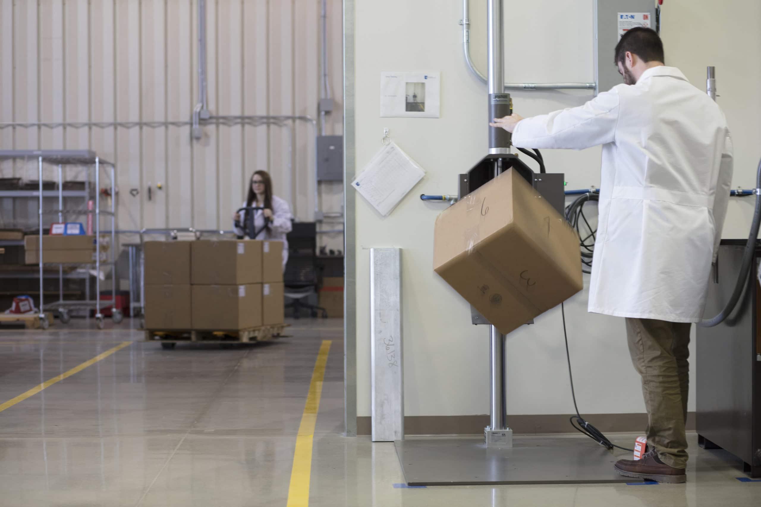 PCL lab tech performing drop testing